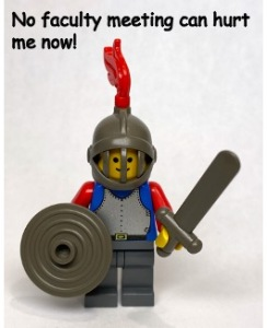 A Lego knight with shield, sword and helmet. It is pretty happy that no faculty meeting can hurt it now.